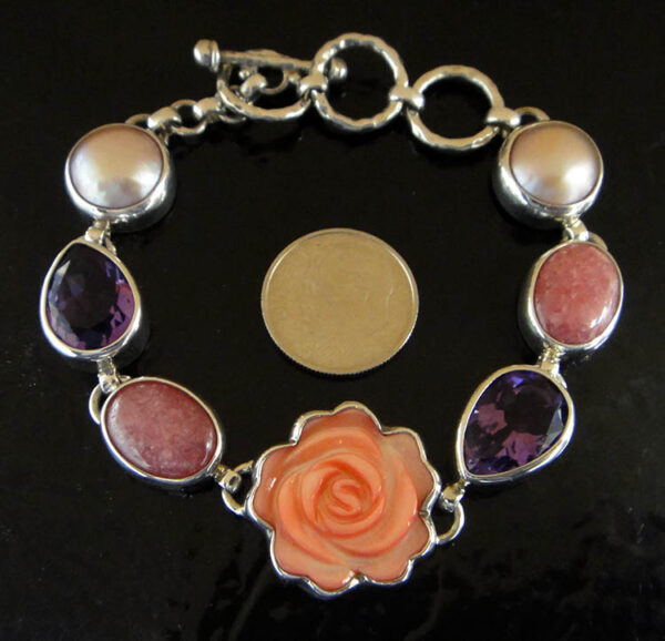 Carved pink mother of pearl shell rose with gemstones bracelet and dime for scale