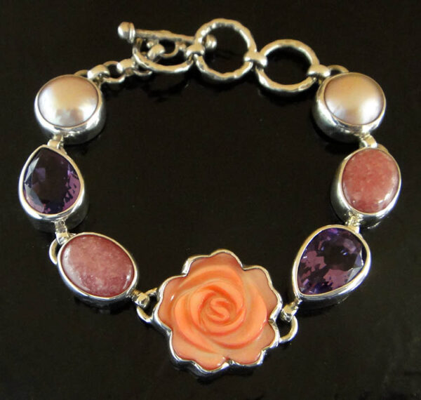 Carved pink mother of pearl shell rose with amethyst and pearl