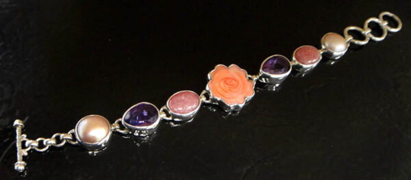 Carved pink mother of pearl shell rose and gemstone bracelet