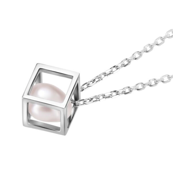close up of pearl in cube