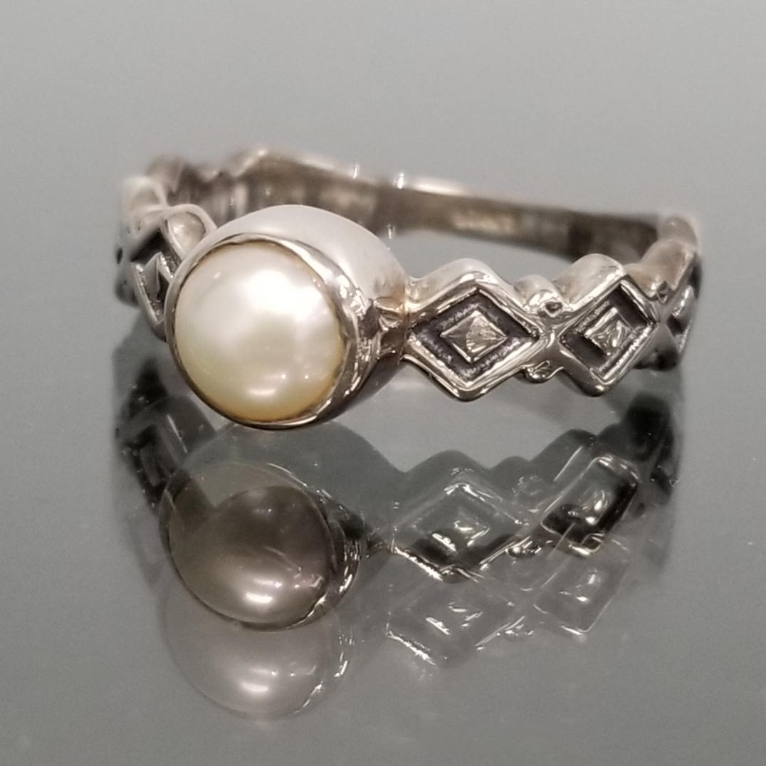 White fresh water pearl ring with etched sterling silver sides