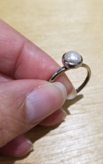 pearl ring in hand