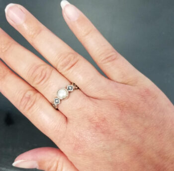 top view of pearl ring on hand