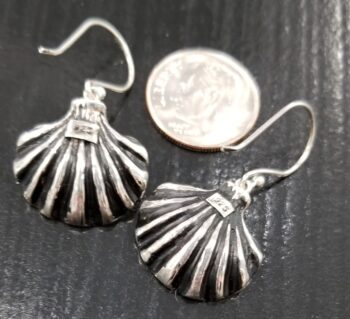 back of oyster shell earrings with dime for scale