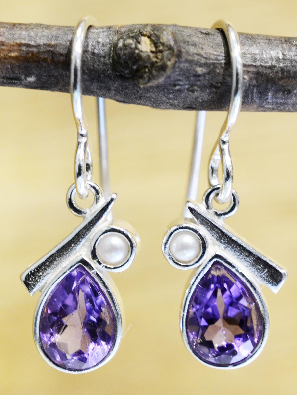 These pear shaped amethyst and pearl earrings are handmade by Sonoma Art Works.