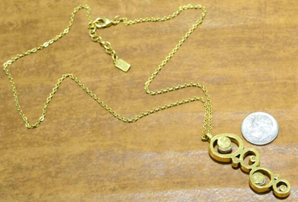 """back of Peekaboo style necklace in color """"Fling"""" by Patricia Locke with dime for size"""