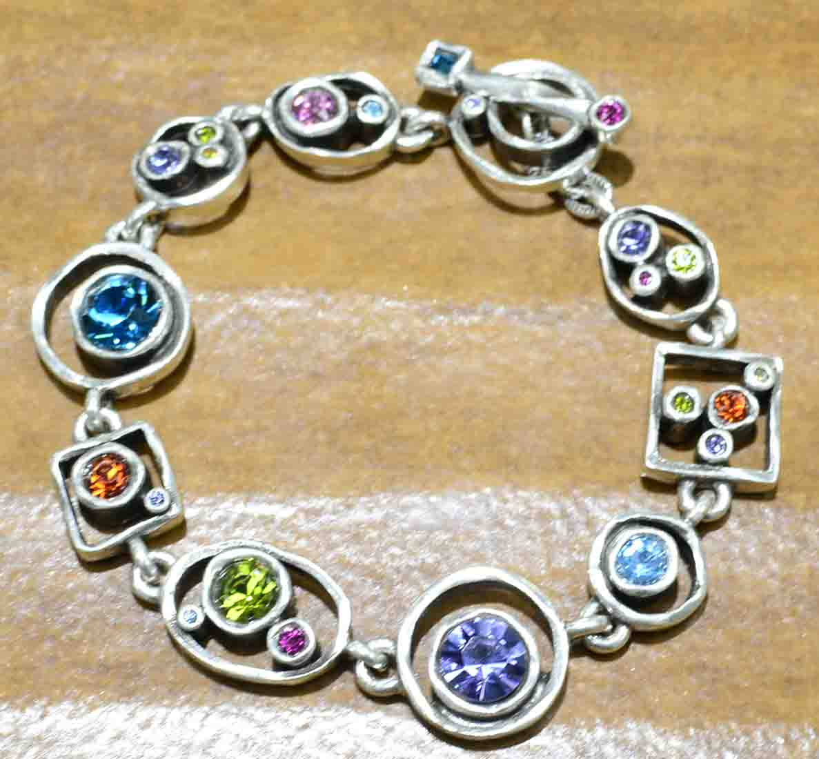 "Penny Arcade silver tone bracelet in the color palette ""Fling"""