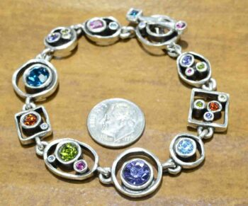 "Penny Arcade bracelet in color palette ""Fling"" by Patricia Locke with dime for size"