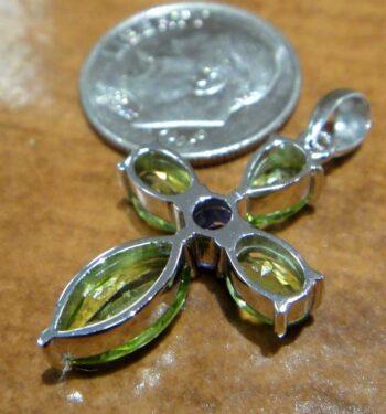 Handmade peridot and amethyst cross pendant back view