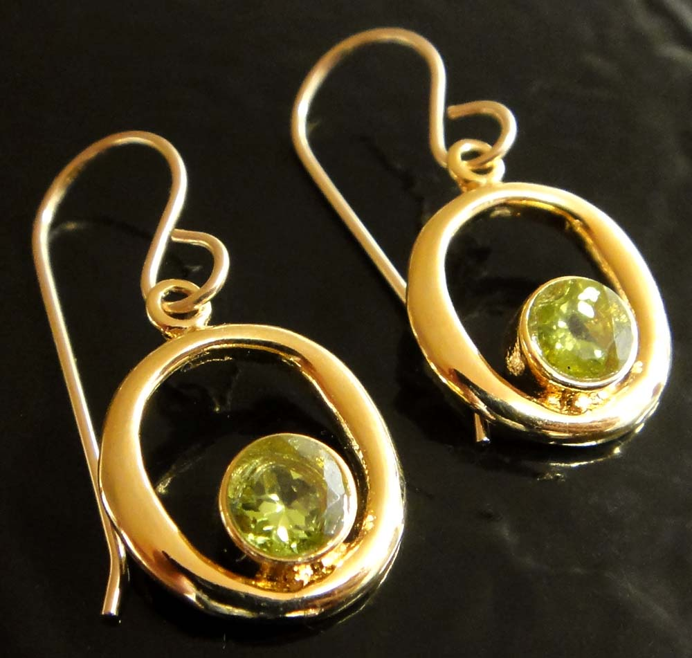 These peridot and 14 k gold vermeil earrings are handmade by Sonoma Art Works.
