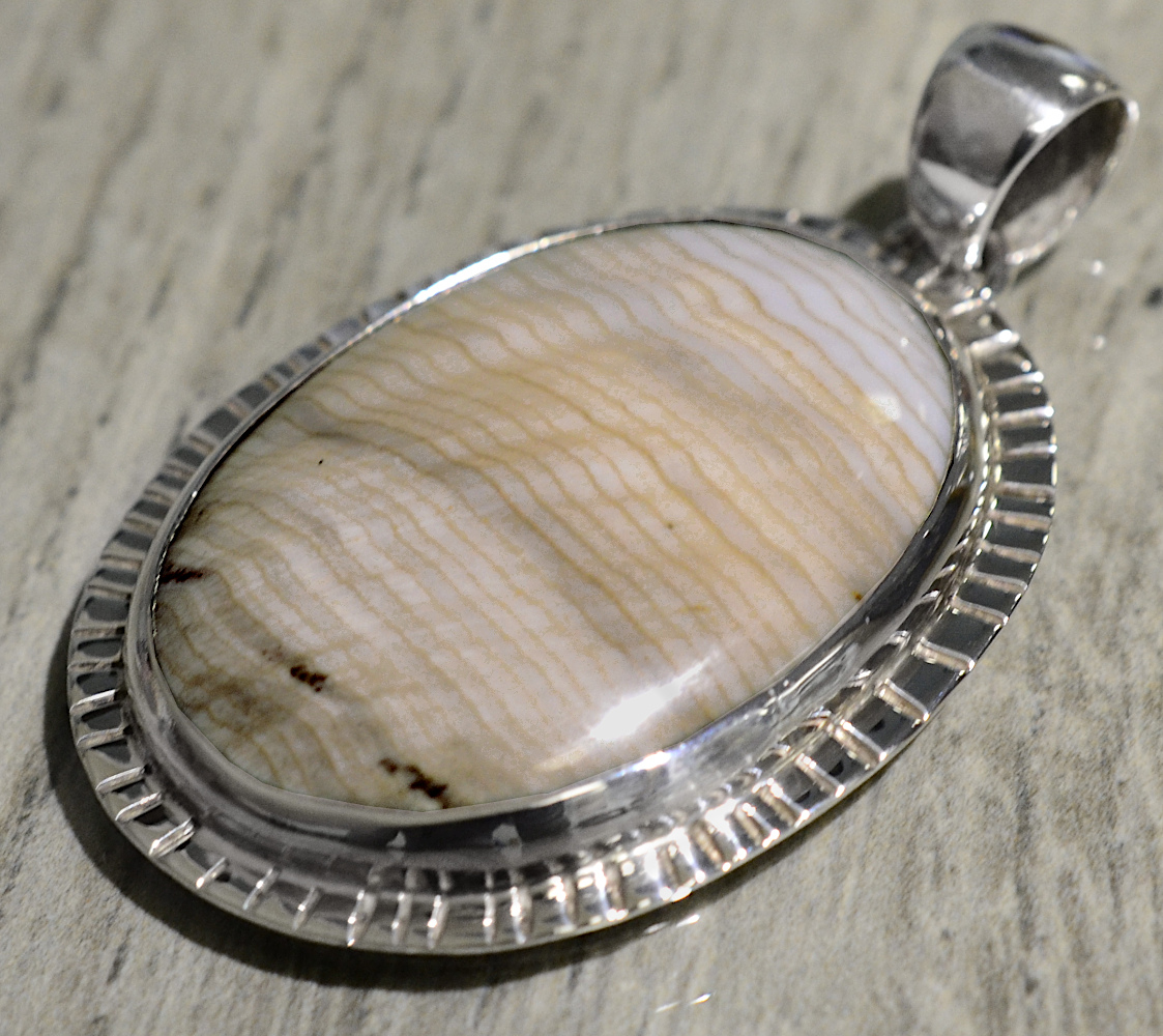 handmade petrified sequoia wood and silver oval pendant