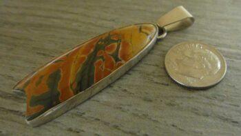 picante jasper pendant with dime for size