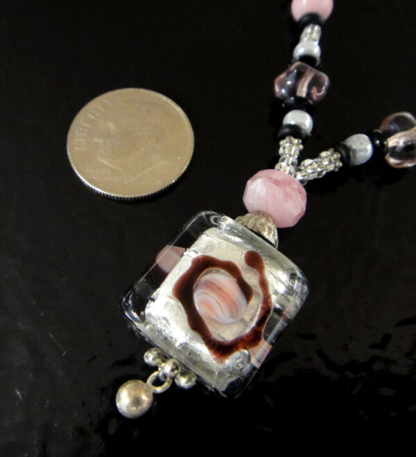Pink and black murano glass necklace close up