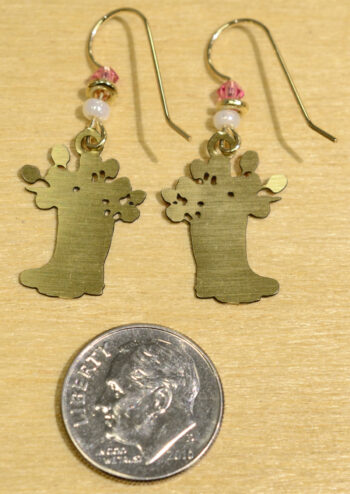 back of pink flowers in pink rain boots earrings with dime