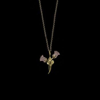 pink rose bud necklace black background