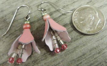 back of 3D pink flower earrings by Sienna Sky with dime for size