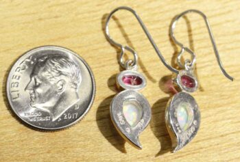 Back of created white opal and pink topaz earrings (pictured with dime for scale)