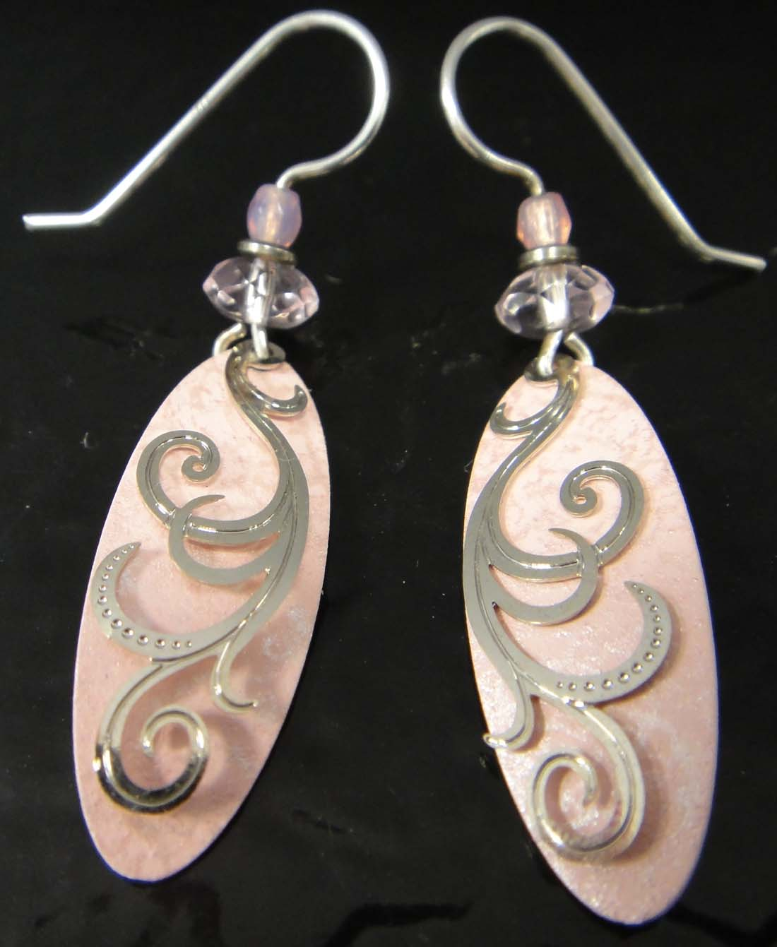 These pink dangle earrings are handmade by Adajio.