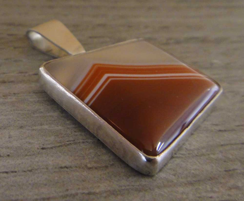 handmade red piranha agate and sterling silver pendant by Dale Repp