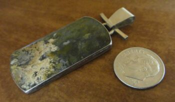 Handmade plume agate and sterling silver pendant shown with dime (not included) for scale
