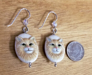 Porcelain cat and sterling silver dangle earrings with dime for scale