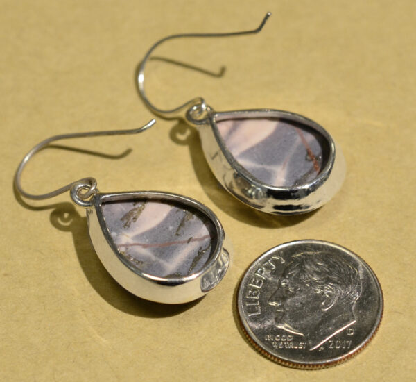 back of gray and pink porcelain jasper drop earrings with dime