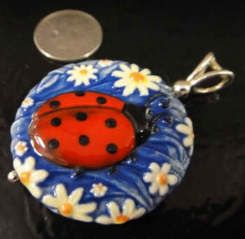 ladybug and daisy pendant with dime for scale