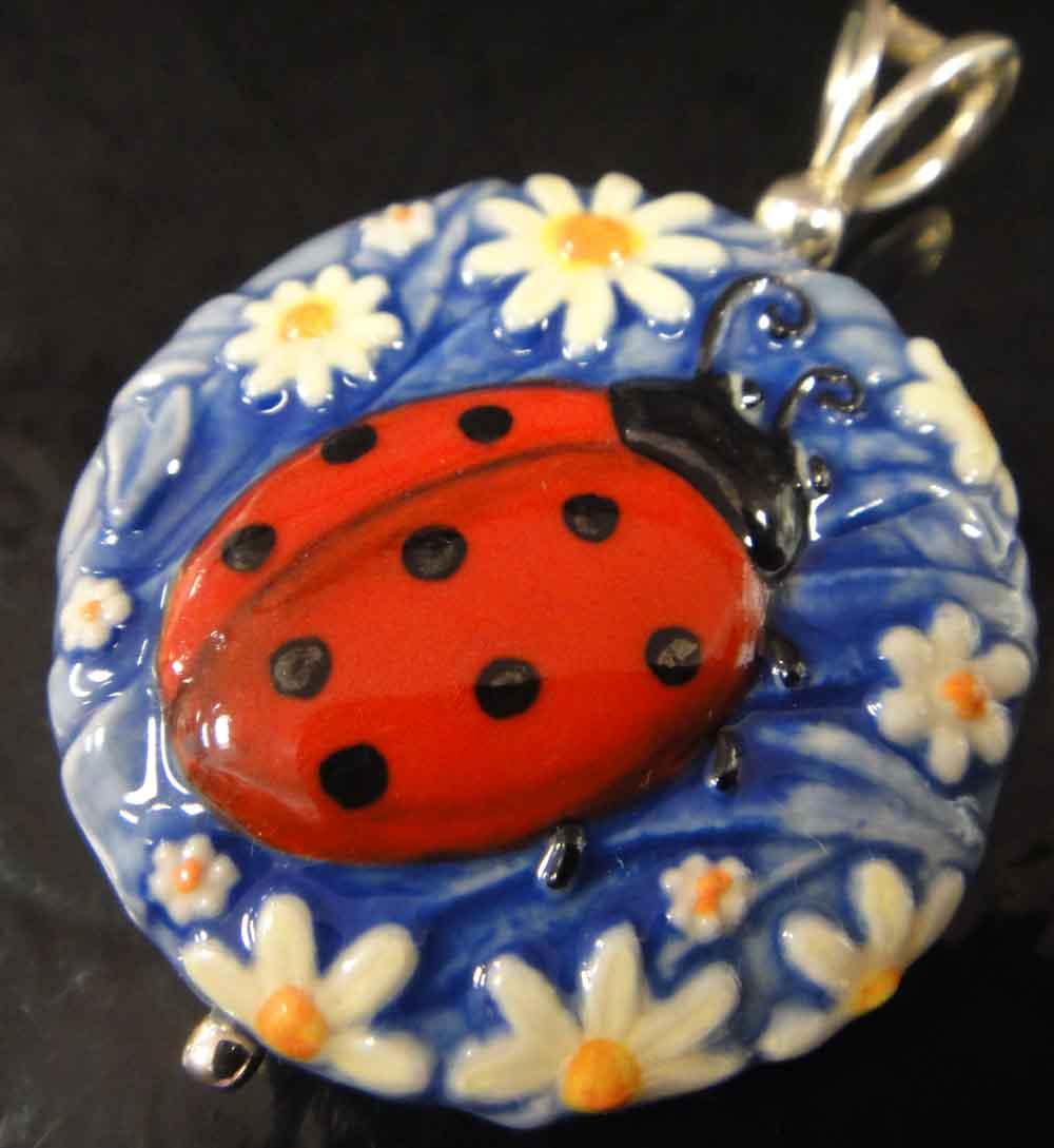 ladybug and daisy pendant