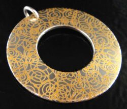 Handmade printed sterling silver circle pendant with swirls