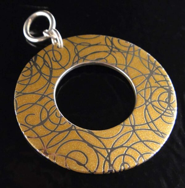 Handmade printed sterling silver pendant with swirls