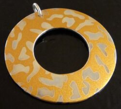 Handmade printed sterling silver pendant with animal spots