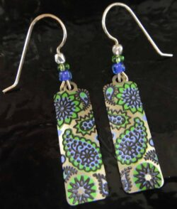 These green and purple paisley patterned earrings are handmade by Adajio.