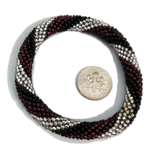 purple, black, and silver-tone Czech glass roll-on bracelet with dime to help judge scale