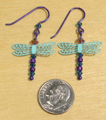 back of teal and purple beaded dragonfly Sienna Sky earrings with dime