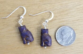dark purple cat earrings with dime for scale