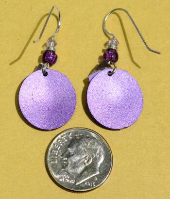 back of Adajio silvertone triangle on purple circle earrings with dime