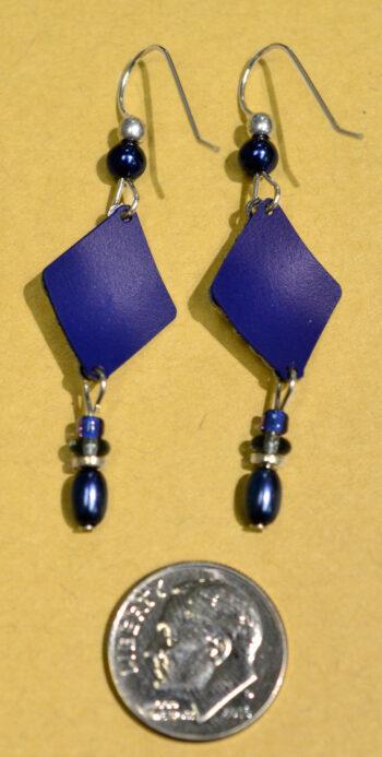 back of Dark Blue and silvertone swirl adajio earrings with dime