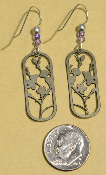 back of Sienna Sky purple flower blossom earrings with dime
