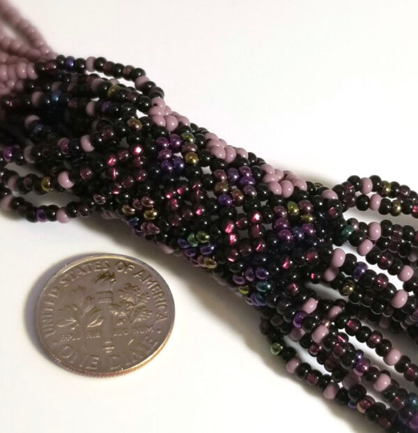 detail of purple seed bead necklace with dime for scale