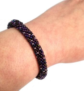 purple bracelet on wrist