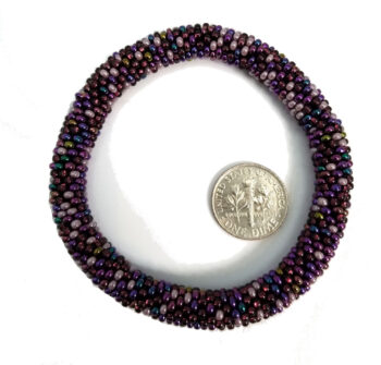 purple seed bead roll-on bracelet with dime to judge scale