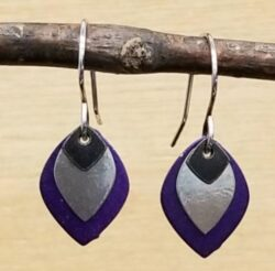 black, silver-tone, and purple earrings