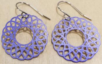 purple spiral dangle earrings by Joseph Brinton