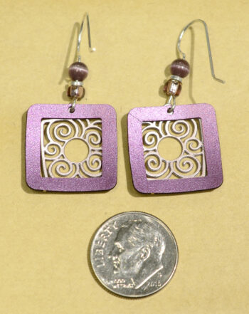 back of purple square with swirls Adajio earrings with dime