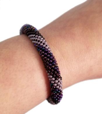 purple roll-on bracelet on wrist