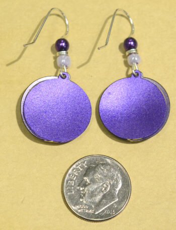 back of purple circle with swirls earrings with dime