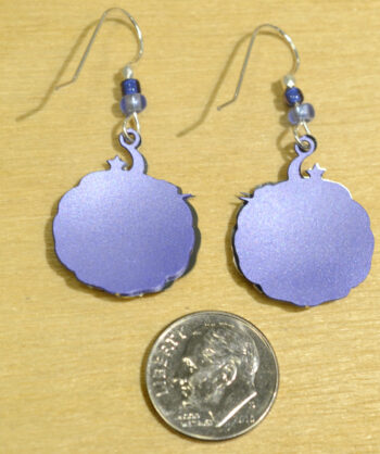back of Sienna Sky purple unicorn dangle earrings with dime