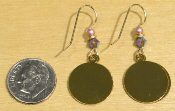 back of pink and purple sunset beach Sienna Sky dangle earrings with dime