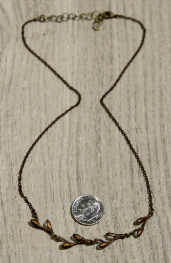 Back view of Michael Michaud's pussy willow necklace, shown with dime (not included) for scale