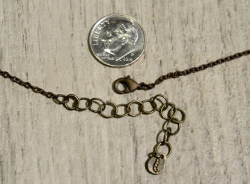 Clasp for pussy willow necklace, shown with dime (not included) for scale